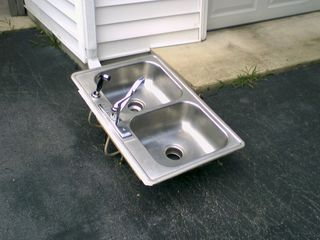On July 27, while I was in Northern Virginia visiting Matthew Tilley, we finally got the kitchen counters replaced at home. What a strange sight it was to see the old kitchen sink sitting out in the driveway as I was leaving.