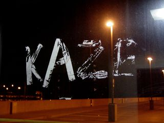 """This """"KAZE"""" message was applied to the elevator windscreen using duct tape on the top level of the North Garage at Vienna some time in mid-2006. No idea what it means, though."""