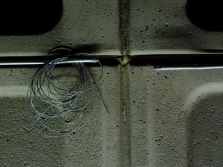 Later on in the day when I was at Pentagon City, the appearance of the sound system has changed. The boxes are gone, and wires are sticking out of the conduit along the wall.