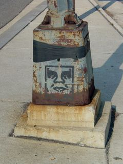 On the way to the Key Bridge, I found this face stenciled on the bottom of a lamppost.