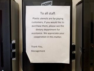 Sign indicating that staff is not allowed to take plastic utensils without making a purchase. Also a run-on sentence.