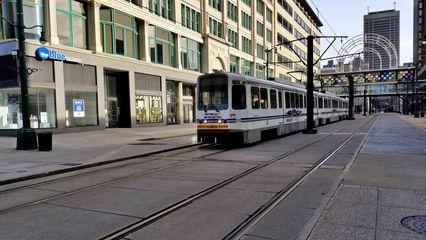 Buffalo Metro Rail vehicle traveling down Main Street.