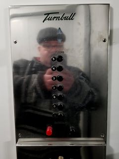 Turnbull buttons on the elevators at the Banting Institute.