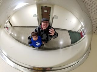 Elyse and I got some photos off of a hallway mirror on our way out.