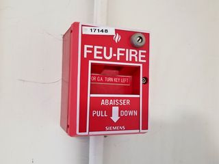 Fire alarm pull station at SickKids.