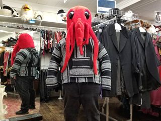Elyse had me try on a red sea creature head, to much amusement all around.