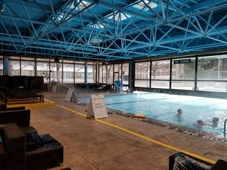 I was surprised to see that the pool was half indoors and half outdoors, and that despite the winter-like temperatures outside, the outdoor portion of the pool was completely open, and one could swim between the indoor and outdoor sections.