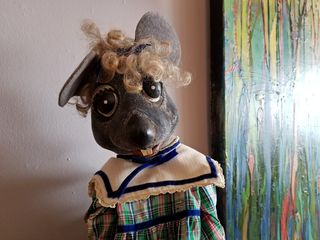"""Muffy poses for a photo. Shs is wearing the outfit that she wore at the beginning of """"A Visit to the Opera""""."""