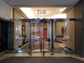 """The entrance to 2180 Yonge Street. The area above the door was solid rather than glass when """"Our Story Part 2"""" was filmed."""