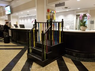 """When we got back to the hotel, we checked out the """"Kids Check-In"""" area. There, children can go up the steps, sound the gong, and get a toy."""