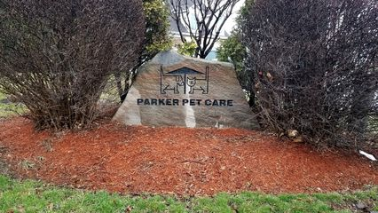 Stone sign for Parker Pet Care in front.