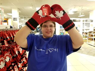 Elyse shows off some Canada-themed mittens at Hudson's Bay.