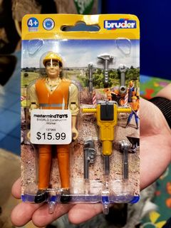 We found a toy set with a manufacturing error, seen at left. Clearly, this construction worker wasn't supposed to be facing away in the package, but there he was. Rather, he was supposed to be facing outward, like the otherwise identical set to the right.