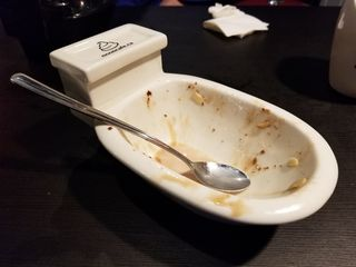 The toilet-shaped bowl that Elyse's sundae came in after she finished it.
