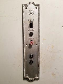 Elevator panel at Chronic Ink.