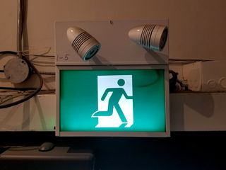 Euro-style exit sign, the standard for new installations in Ontario since 2014.