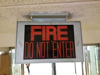 Fittingly, we exited the subway through a direct entrance into the store. This sign was located over the entrance where we came in from the subway. I assume that this is connected to the store's fire alarm system, and lights up whenever the alarm system is activated.