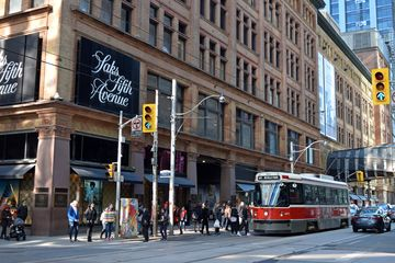 """This photo of the store's Queen Street facade, showing a streetcar passing by, was inspired by the establishing shot at the beginning of """"Our Story Part 1""""."""