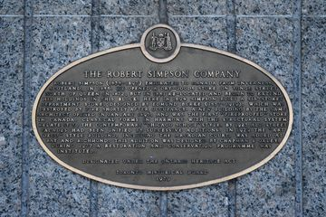 """The plaque, located at the subway entrance. Note the reference to a fire with the 1894 structure, whch Jodie briefly references in """"Our Story Part 1"""", explaining that the records for the age of the store were destroyed in a fire."""