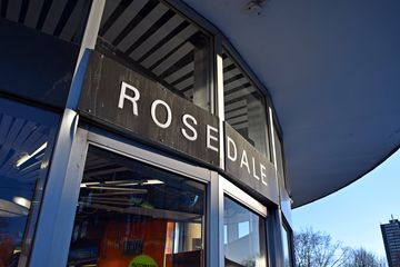 And now, welcome to Rosedale, starting with the establishing shot. This shot started at the big TTC sign on top, panned past the sign over the door, and then down to Sam and Jodie.