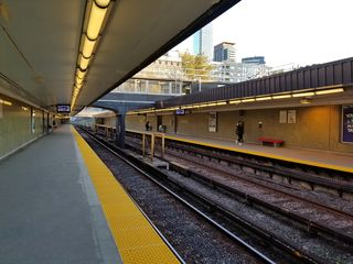 """View from the Finch-bound platform at Rosedale. The clock and destination signs have been replaced with digital displays. Since """"Trains"""" was made, the station has seen very few changes."""