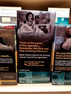 """Here's an example on a carton of Benson & Hedges, depicting Barb Tarbox, a lifelong smoker who became a very outspoken anti-smoking activist in her final months before dying of smoking-related health problems. I have to admit, though, that """"Tarbox"""" is the perfect last name for a smoker."""