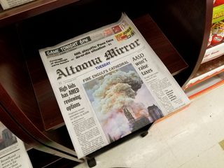 Local newspapers for sale at Weis. The big story of the day was the fire at Notre Dame Cathedral in Paris.