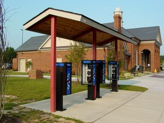 Outside the rest area building, the usual facilities can be found, though with a more updated look to them. Note how the picnic table is not in line with the sidewalk and the canopy - it's at an angle! Also notice the bench - much more ornate, and sporting an outline of Virginia, which actually ended up being a recurring theme here.