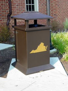 Waste receptacles, both for trash and for recycling, share the outline-of-the-state theme that is found all over this rest area.
