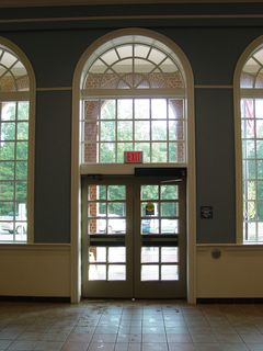 Inside, the building is far more ornate than a regular rest area. Another first - a lobby! In other Virginia rest areas, the closest thing to a lobby is where there is an open-air corridor running down the center of the building on some floorplans. Nothing like this, with climate control, big fan windows, and televisions set to CNN.