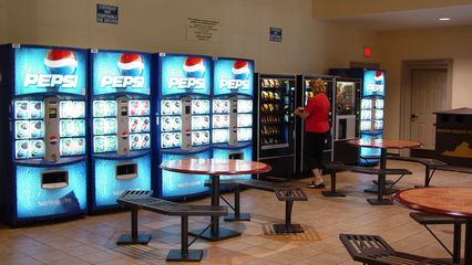 The vending machine area, usually in its own building in other rest areas where it's offered, is located right off the main lobby. It even features indoor seating!