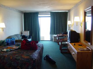 As I mentioned before, the Ocean Holiday, which I gave a second chance in 2004 after not being all that satisfied in 2000, did a LOT better on its overall experience this year. All the lights worked. The refrigerator (seen to the left of the window in the right image) had all its pieces in place. An ice bucket was present. Additionally, the front desk staff was much more helpful this time around. It was enough to change my opinion of the hotel, and recommend it to others.