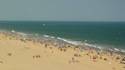 """The view from the Ocean Holiday is a good one. The beach is on the balcony side, and is more than twice as wide as it was in 2000 after a beach nourishment program called """"Operation Big Beach"""" was completed in 2001. The other side, seen from the windows in the corridor, is the Virginia Beach strip, otherwise known as the """"resort area"""", and beyond."""