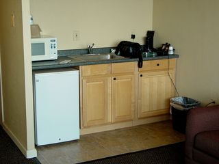 The kitchenette had a coffee maker, a refrigerator, some cabinets, and a microwave. The kitchenette also became the home of Big Mavica, as I kept the camera bag and charger plugged in here. I also kept my cell phone on the charger here, too.