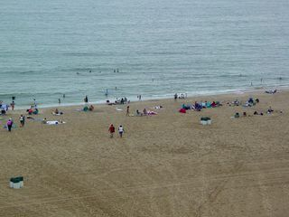Despite the clouds, wind, and rain, the beach was still well attended.