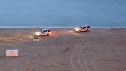 Two vehicles for the Virginia Beach Lifesaving Service were on the beach, but I had no idea what they were doing at this time...