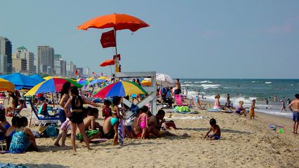 The beach and the ocean were just teeming with people.