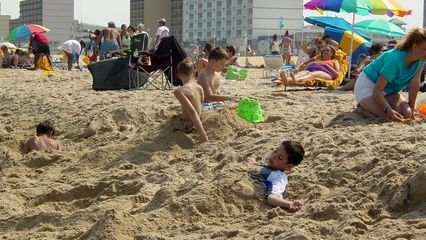 Some people spent time burying each other in the sand as part of their fun in the sun...