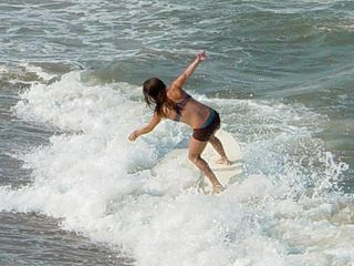These people tried their hand at surfing, and did quite a job on it, too.