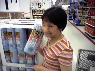 Near the Automotive department, Becky poses with a roll of Scott Shop Towels.