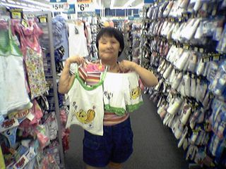 """One of Becky's favorite characters is Tweety, as in """"I tawt I taw a puddy tat"""".  And here he is, on a sleepwear set that we eventually bought, that I helped Becky pick out."""