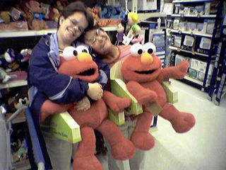 After the ice cream, we stopped by the toy department, where we found these giant Tickle Me Elmo dolls.