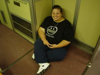 Katie sits on the floor in a corner of Breda 4062 near the cab.