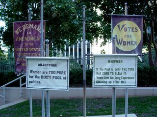 """The women's suffrage banners. Katie found the """"If the pool is dirty"""" message to be the most interesting."""