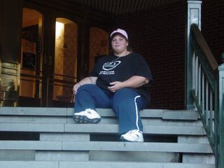 Katie sits on the steps at the back entrance to The Shops at Georgetown Park.