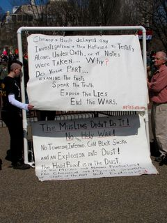 """A short distance from the main demonstration, a group of """"9/11 truthers"""" demonstrated."""