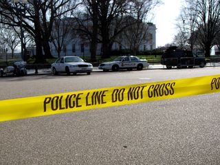 Police tape in front of the White House.