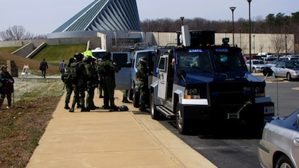 Virginia State Police SWAT vehicle, complete with masked officers.