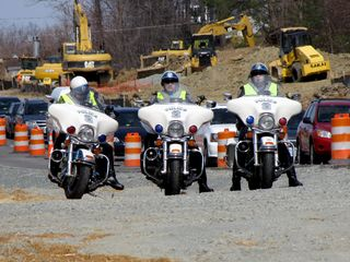 A Prince William County Police cruiser, as well as three Prince William motorcycles, soon arrived at the roadside. There were absolutely too many police at this demonstration. Your tax dollars at work.