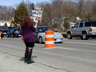 Some demonstrators walked along the roadside, holding up their signs for the traffic on Route 1 to see.